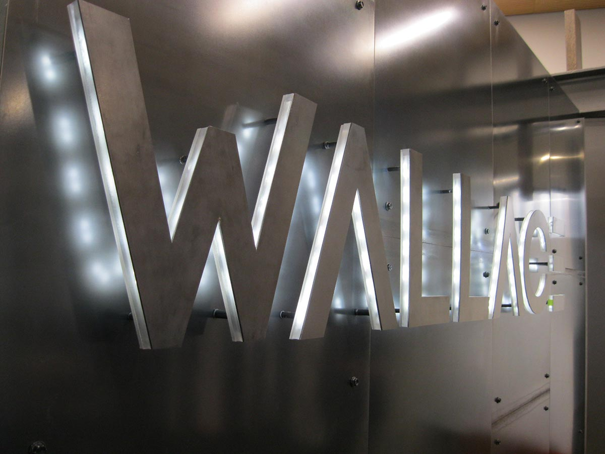 Wallace Construction gets brushed metal panelling in reception
